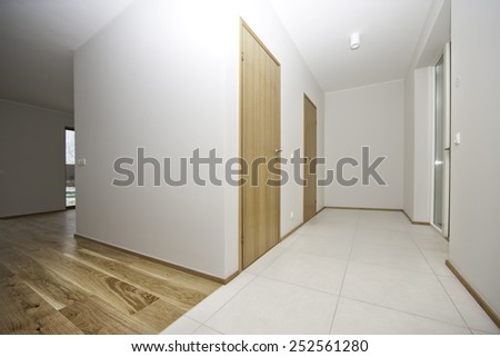 empty room with two doors wooden  and tiles flore - stock photo