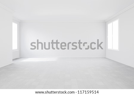 Empty room with two windows and radiator attached to wall - stock photo