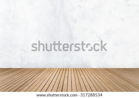 Empty room with white concrete wall and wooden floor - stock photo