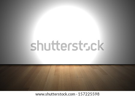 Empty room with white wall, wooden floor and a spot light - stock photo