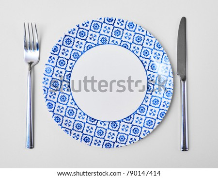 Empty Round Plate with Fork and Knife Top View Isolated on  white Background. Table Setting