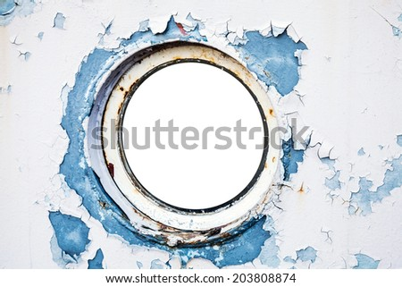 Empty round porthole in white and blue ship wall - stock photo