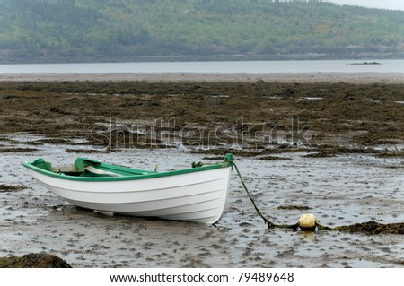 Empty rowboat at Western Ireland - stock photo