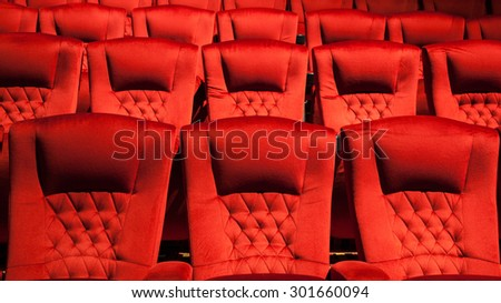 Empty rows of red theater or movie seat sows of red cinema seats - stock photo