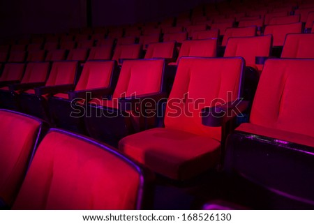 Empty rows of red theater or movie seats