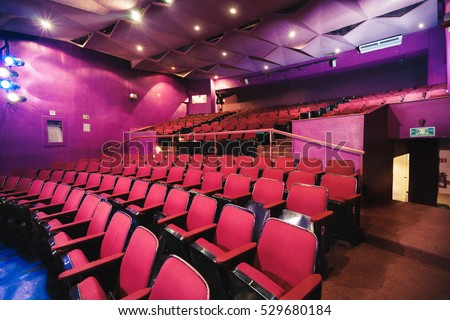 Empty rows of theater seats