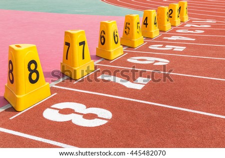empty running track with number in stadium  - stock photo
