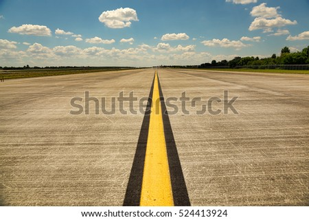 Empty runway in the airport on a hot and sunny summer day
