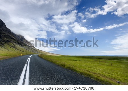 Empty rural lonely country road in South Iceland./Lonely Road Twilight - stock photo
