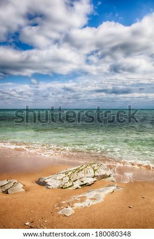 Empty sandy beach near the sea. HDR image - stock photo