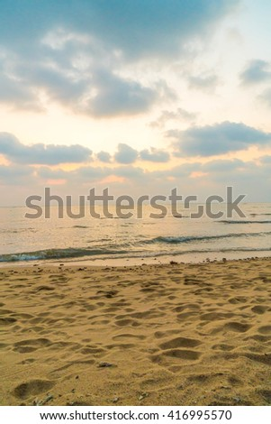 Empty sea and beach on sunset time background with copy space