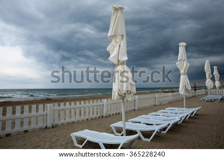 Empty sea beach before storm with dramatic high contrast clouds - stock photo