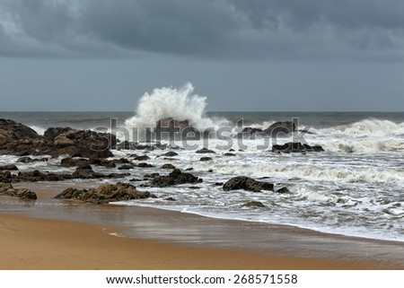 Empty seaside from the north of Portugal seeing waves crashing against the rocks - stock photo