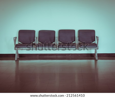 Empty seat at the airport in retro style - stock photo