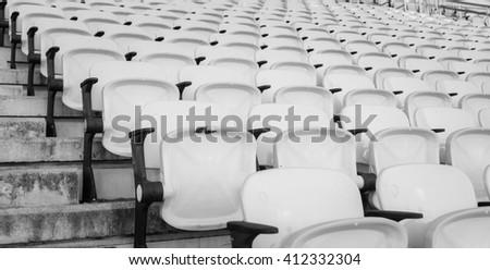 Empty seats at soccer stadium , black and white. - stock photo