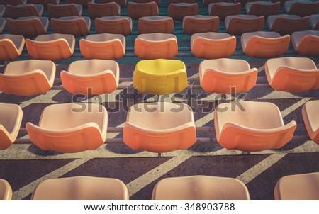 Empty seats at soccer stadium , vintage - stock photo