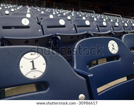 Empty seats during a rain delay in Washington Nationals baseball stadium.