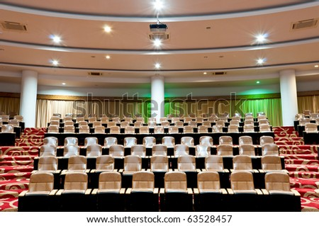 empty seats in conference room interior - stock photo
