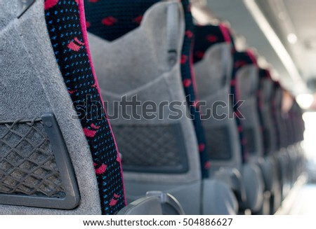 Empty seats in tourist bus.