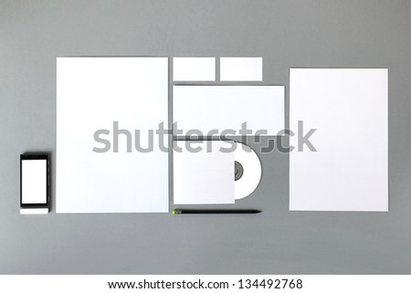 Empty set: sheet A4, envelope, business card, folder, smartphone, pencil - stock photo