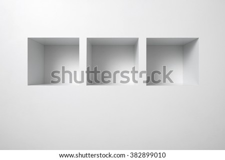 Empty shelf for exhibit in white wall. - stock photo