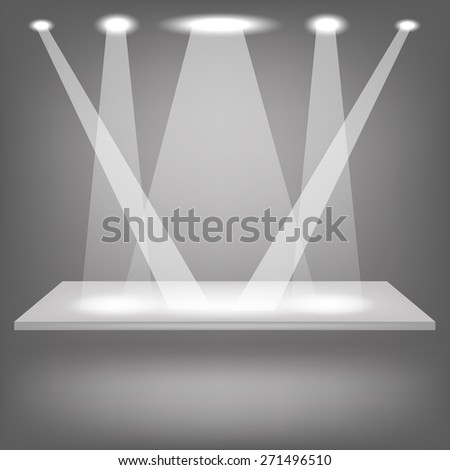 Empty Shelf Isolated on Grey Background. Spotlights Illuminated the Empty Shelf. - stock photo