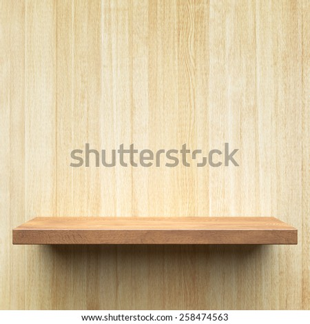 Empty shelf on a wooden wall