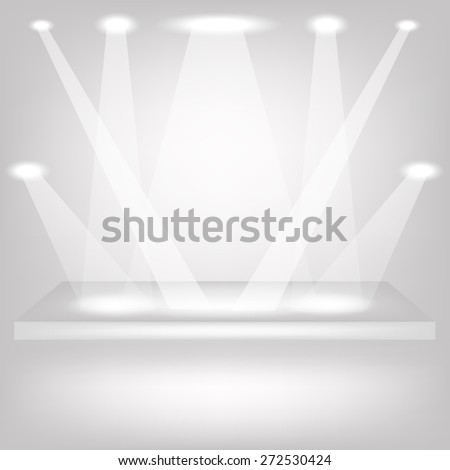 Empty Shelf on Grey Background. Spotlights Illuminated the Empty Shelf. - stock photo