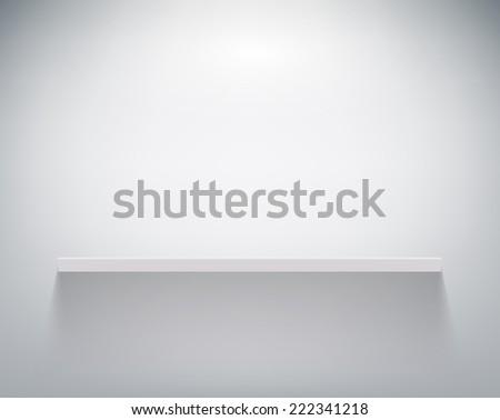 empty shelf on white wall - stock photo