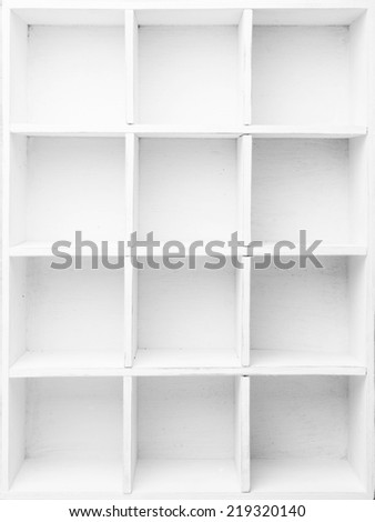 Empty Shelves in the white wooden rack - stock photo