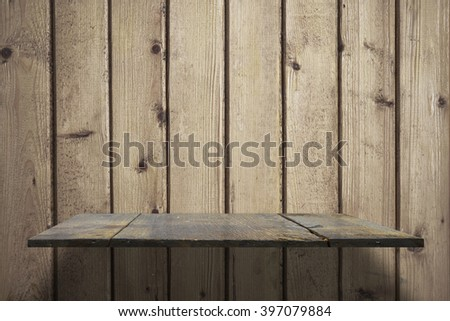 empty shelves on wooden wall - stock photo
