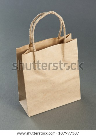 Empty Shopping Bag from craft paper, Recycled paper shopping bag on gray background