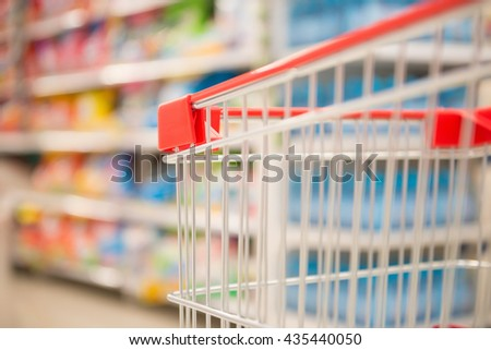 empty shopping cart in a supermarket - stock photo