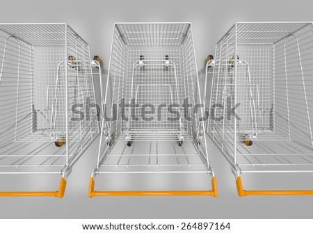 Empty shopping cart in grey studio - stock photo