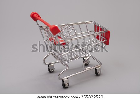 Empty Shopping Cart On Gray Background