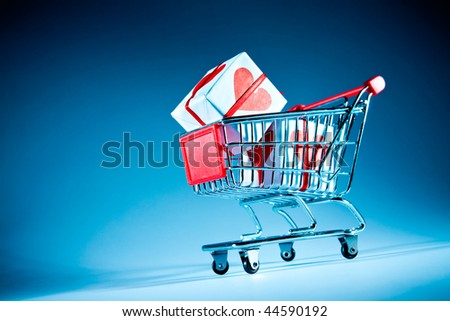Empty shopping cart on the blue