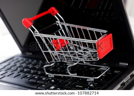 empty shopping cart on the laptop, on-line shopping concept. - stock photo