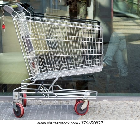 Empty shopping cart trolley. Market grocery shop and retail concept. Outdoor.