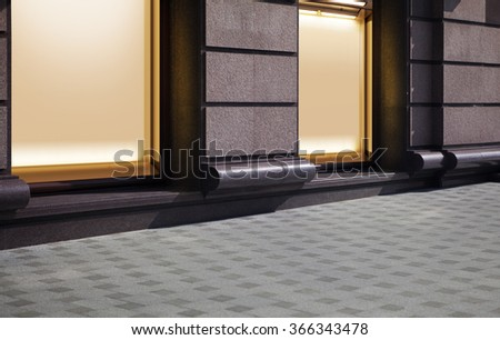 empty show window of shop, city street at night - stock photo