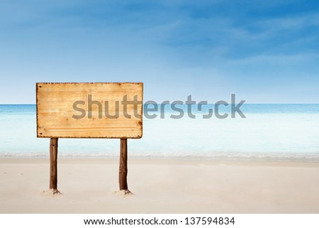 empty sign board with copy space on a beautiful tropical beach - stock photo