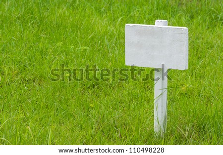 Empty signboard on grass