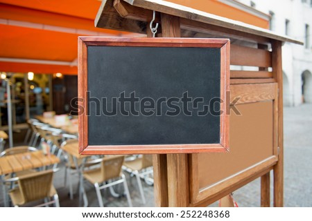 Empty signboard outside summer cafe. - stock photo