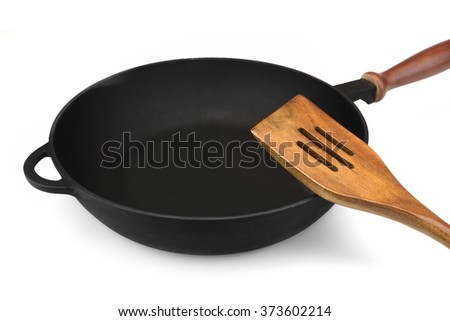 Empty Single Modern Vintage Cast Iron Pan With Wooden Handle And Spatula Isolated  On White Background, Top View, Close Up - stock photo