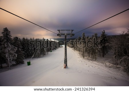 empty ski lift in the evening - stock photo