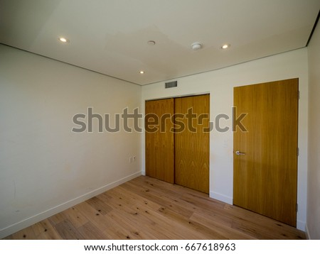 Wood Floor Small Bedroom. Empty small bedroom modern style interior with wood floor built in  closet door Small Bedroom Modern Style Interior Stock Photo 667618963