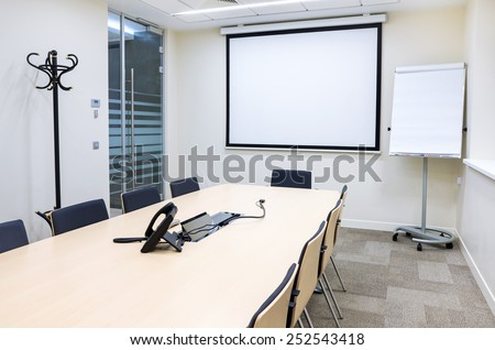 Empty small bright meeting room with TV proektor screen and flipchart. Modern design - stock photo