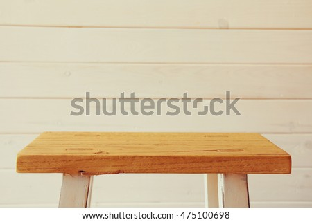 Empty small table in front of wooden planks background. For product display