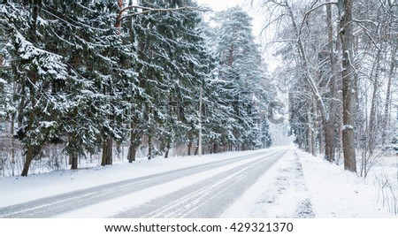 Empty snowy rural road background, cold winter season transportation - stock photo