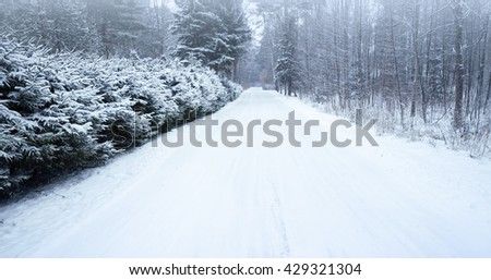 Empty snowy rural road photo background, cold winter season transportation - stock photo