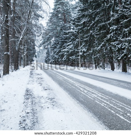 Empty snowy rural road, square photo background, cold winter season transportation - stock photo